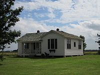 Cash's boyhood home in Dyess, Arkansas, where he lived from the age of three in 1935 until he finished high school in 1950. The property, pictured here in 2013, is listed on the National Register of Historic Places.