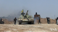A YPG T-55 in Tell Tamer during the Western al-Hasakah offensive in Syria, 22 May 2015.