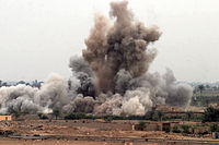 An airstrike destroys a suspected insurgent hideout in Fallujah during the Second Battle of Fallujah, 8 November 2004.