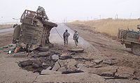 A US Army Stryker following an IED blast near a village outside Baghdad, during Operation Imposing Law, 15 April 2007.