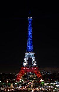 The Eiffel Tower in Paris lit in blue white red in the aftermath of the November 2015 Paris attacks, 21 November 2015.