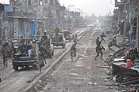 Pakistani forces clear the village of Mirali in North Waziristan, Pakistan, as part of Operation Zarb-e-Azb