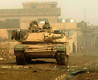 An M1 Abrams Tank from the U.S. 3rd Armored Cavalry Regiment conducting a security cordon for a search operation in Biaj during the Ninawa campaign of Operation Phantom Phoenix. May 2008.