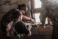 YPG and YPJ fighters of the Syrian Democratic Forces in combat during the Raqqa campaign.