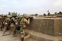 U.S. Marines from the 2nd Marine Division and an Iraqi soldier engage insurgents during Operation Steel Curtain, a subsidiary operation of Operation Sayeed, 7 November 2005.