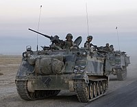 U.S. Army M106 mortar carriers of the 1st Infantry Division leaving Samarra after conducting an assault there during the Battle of Samarra, 1 October 2004.