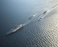 The, escorted by, and FS Jean Bart in the Persian Gulf for strike operations in Iraq and Syria. 10 November 2014.