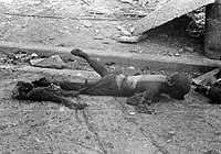 The charred remains of a woman who was carrying a child on her back, Tokyo 1945