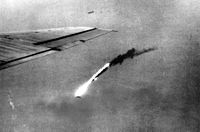 A B-29 falls in flames after a direct hit by an anti-aircraft shell over Japan