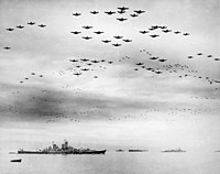 US Navy carrier aircraft flying over the Allied fleet in Tokyo Bay following the Japanese surrender on 2 September 1945