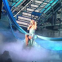 """Spears performing the album's tenth track, """"Shadow"""", during The Onyx Hotel Tour in 2004."""