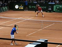 Federer receiving serve against Richard Gasquet in the title clinching match for Switzerland at the 2014 Davis Cup