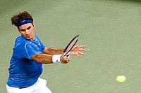 Federer hits a forehand at the 2006 US Open, where he became the first man in history to achieve the Wimbledon-US Open double for three consecutive seasons.