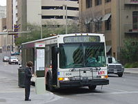 A VIA bus stopped at a Downtown San Antonio intersection