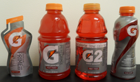 """<div class=""""center"""" style=""""width:auto; margin-left:auto; margin-right:auto;"""">G Series introduced in 2010, from left to right: Prime 01 (pre-game fuel) Perform 02: Gatorade Thirst Quencher (original Gatorade) Perform 02: G2 low-calorie Recover 03 (post-game protein)"""