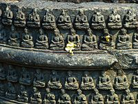Details on one of numerous votive stupas at the site