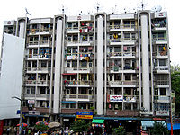 A block of apartments in downtown Yangon, facing Bogyoke Market. Much of Yangon's urban population resides in densely populated flats.