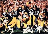 The Steelers defeated the Rams in Super Bowl XIV to win an unprecedented four championships in six years.