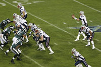 The Patriots playing against the Eagles in Super Bowl XXXIX