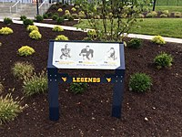 A plaque dedicated to Mountaineer Legends Society members Paul Bischoff, Chuck Howley and Sam Huff in the Legends Park area located on the north end of Mountaineer Field.