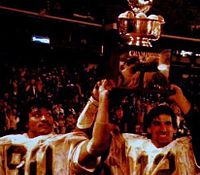Darryl Talley and Oliver Luck celebrate WVU's 1981 Peach Bowl victory.