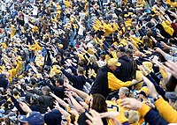 """Mountaineer fans perform the """"1st Down"""" cheer"""