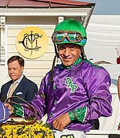 Espinoza in the winner's circle of the 2014 Preakness Stakes