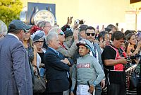Espinoza (in gray silks) with Art Sherman before the 2016 Breeders' Cup Classic