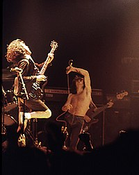 Former vocalist Bon Scott (centre) pictured with guitarist Angus Young (left) and bassist Cliff Williams (back), performing at the Ulster Hall in August 1979