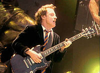 Angus Young performs in Cologne, Germany, in 2001 during the Stiff Upper Lip Tour