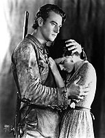 With Marguerite Churchill in the widescreen The Big Trail; John Wayne's first role as a leading man (1930)