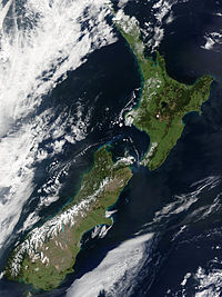 The snow-capped Southern Alps dominate the South Island, while the North Island's Northland Peninsula stretches towards the subtropics.