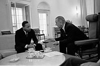 Lyndon B. Johnson, 36th President of the United States (1963–1969), meeting with Martin Luther King Jr. at the Oval Office in 1963.
