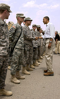 President Barack Obama shaking hands with an American soldier in Basra, Iraq in 2008.