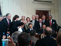 President Barack Obama signing the Patient Protection and Affordable Care Act into law at the White House on March 23, 2010
