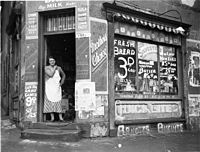 A Corner grocery store during the Great Depression, Bourke & Fitzroy Streets, Surry Hills, Sydney, 21 August 1934.