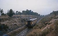 A short-lived South Maitland Railway (SMR) Railcar travelling between Weston and Abermain, 1962. The SMR is notable for being the second last system in Australia to use steam haulage.
