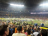 Members of the Toronto Argonauts run onto the field of the Rogers Centre, after winning the 100th Grey Cup in 2012