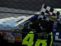 Johnson holding the checkered flag at the 2008 Tums QuikPak 500