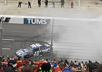Johnson performing a burnout at the 2012 Tums Fast Relief 500