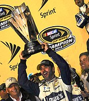 Johnson holding the Sprint Cup trophy after clinching his seventh Cup Series title with a win in the 2016 Ford EcoBoost 400