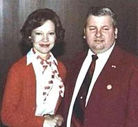 Gacy with First Lady Rosalynn Carter on May 6, 1978, six years after the killings began and seven months before his final arrest. A pin indicating special Secret Service clearance is visible on his jacket.