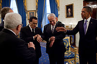 During 2010 Middle East negotiations in the United States, Hosni Mubarak and Benjamin Netanyahu check their watches to see if the Sun has set.