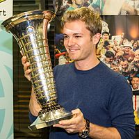 Rosberg holding the 2016 Formula One World Drivers' Championship trophy