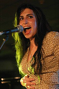Winehouse performing live in July 2004.