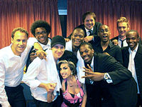 Winehouse backstage with her band in March 2009.