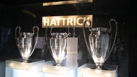 The three consecutive European Cup trophies won by FC Bayern Munich from 1974 to 1976. The one on the far right is the real trophy, given to Bayern permanently. The ones on the left are slightly smaller replicas.