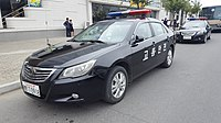 """A North Korean police car in 2017; the Chosŏn'gŭl lettering on the side translates to """"Traffic safety""""."""