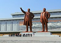 North Korean citizens paying respect to the statues of Kim Il-sung (left) and Kim Jong-il at the Mansudae Grand Monument