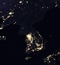 Satellite image of the Korean Peninsula at night, contrasting use of night-time lighting in North and South Korea. A similar contrast is found when comparing night-time maps of Belgium and Germany.